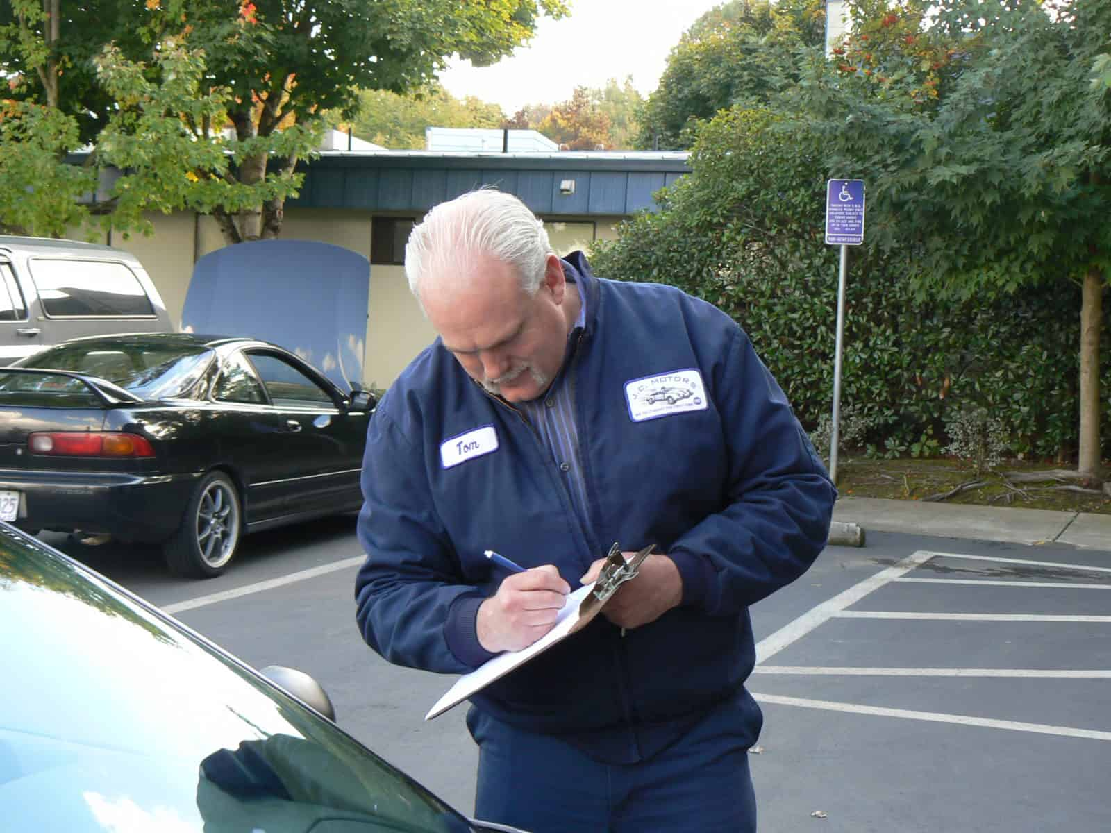 Tom Smith checking in a vehicle.